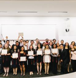 Graduates from Stanford Medical Youth Science Program pose with their certificates at the end of the program.